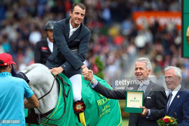 Gregory WATHELET riding COREE during the Rolex Grand Prix part of the Rolex Grand Slam of Show Jumping of the World Equestrian Festival on July 23...