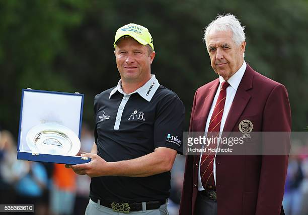 Greig Hutcheon of Scotland poses with his award for the Leading PGA Professional and Nicky Lamb Captain of the PGA during day four of the BMW PGA...