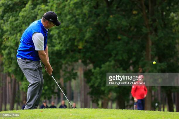 Greig Hutcheon of the Great Britain Ireland PGA Cup Team in action on the 8th green during the Singles Matches on Day 3 of the 28th PGA Cup Matches...
