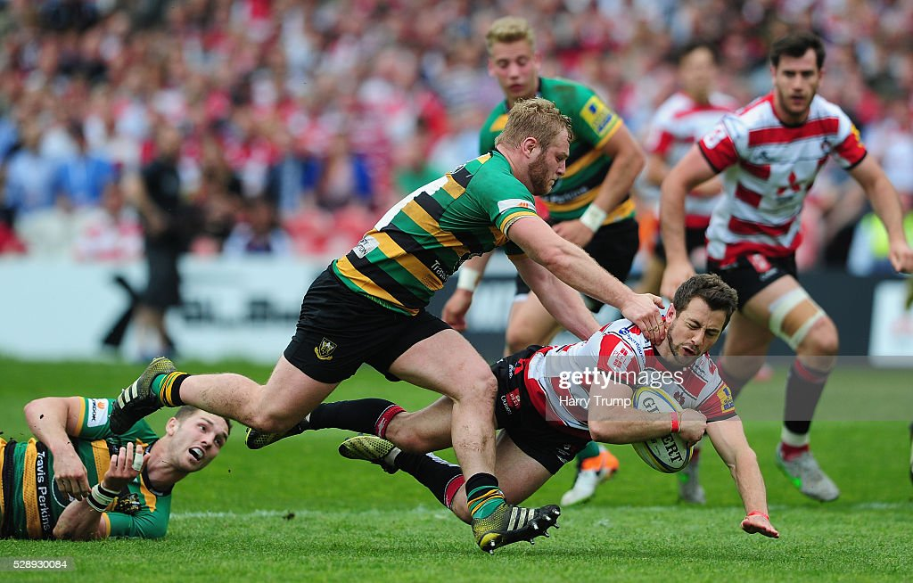 Greig Laidlaw of Gloucester Rugby is tackled by Mikey Haywood of Northampton Saints during the Aviva Premiership match between Gloucester Rugby and Northampton Saints at Kingsholm on May 07, 2016 in Gloucester, England.