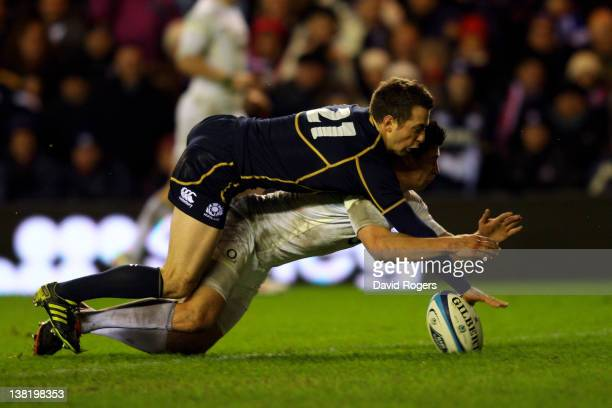 Greig Laidlaw of Scotland appears to touch down the ball for a try ahead of Ben Youngs of England but is is ruled out after a review by the Third...
