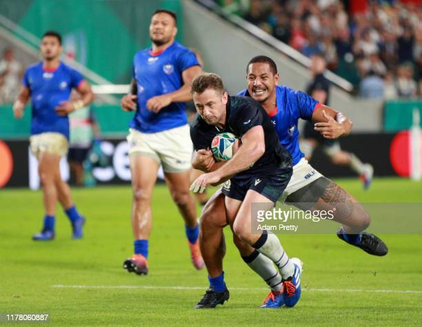 Greig Laidlaw of Scotland breaks through Ed Fidow of Samoa to go on and score his team's second try during the Rugby World Cup 2019 Group A game...