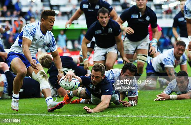 Greig Laidlaw of Scotland scores a try during the 2015 Rugby World Cup Pool B match between Samoa and Scotland at St James Park on October 10 2015 in...