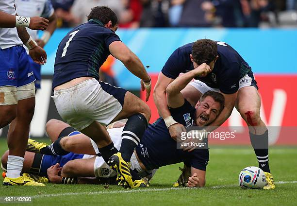 Greig Laidlaw of Scotland scores the third try during the 2015 Rugby World Cup Pool B match between Samoa and Scotland at St James' Park on October...