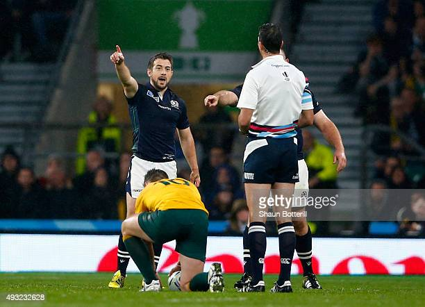 Greig Laidlaw of Scotland talks to referee Craig Joubert after he awarded Australia a late penalty during the 2015 Rugby World Cup Quarter Final...