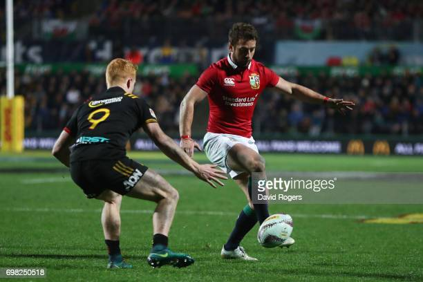 Greig Laidlaw of the Lions kicks downfield as Finlay Christie of the Chiefs closes in during the 2017 British Irish Lions tour match between the...