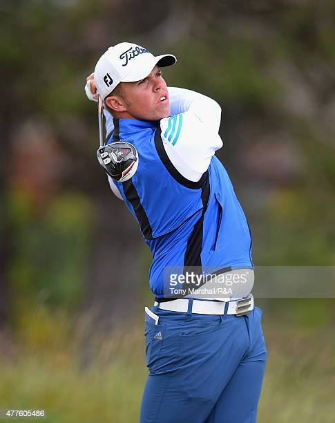 Greig Marchbank of Thornhill of France plays his first shot on the 12th tee during The Amateur Championship 2015 Day Four at Carnoustie Golf Club on...