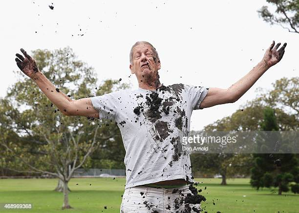 Greig Pickhaver is pelted with mud during a mud fight to raise awareness about the 'Mud Pie Project' to help raise funds to complete the Ian Potter...