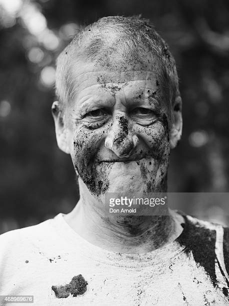 Greig Pickhaver poses after participating in a mud fight to raise awareness about the 'Mud Pie Project' to help raise funds to complete the Ian...