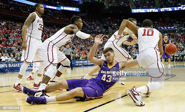 Greig Stire of the Albany Great Danes looses the ball against the Oklahoma Sooners in the second half during the second round of the 2015 NCAA Men's...