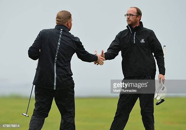 Greig Sutherland of Cherry Lodge Golf Centre shakes hands with Gareth Wright of West Linton Golf Club at the end of a play off at the AAM Scottish...