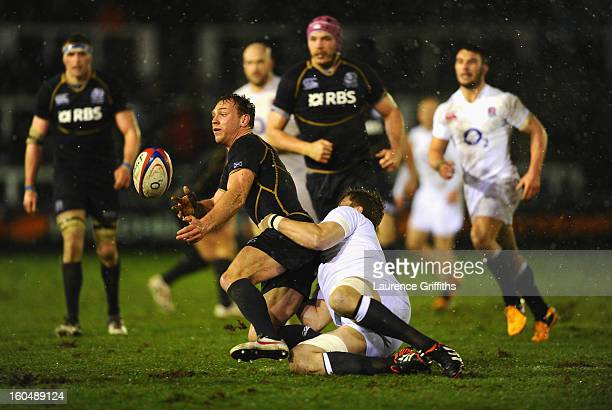Greig Tonks of Scotland is tackled by Ed Slater of England Saxons during the International Friendly match between England Saxons and Scotland A at...