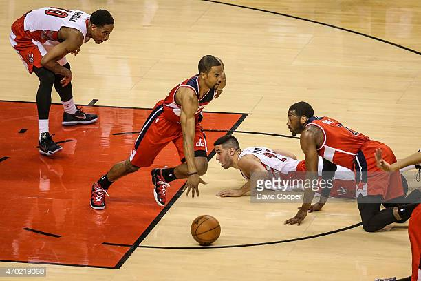 Greivis Vasquez and DeMar DeRozan of the Toronto Raptors loose possession of the ball to Ramon Sessions of the Washington Wizards late in the 2nd...