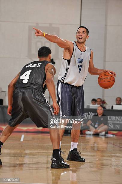 Greivis Vasquez of the Memphis Grizzlies directs the offense while Dominic James of the Milwaukee Bucks guards him during NBA Summer League on July...