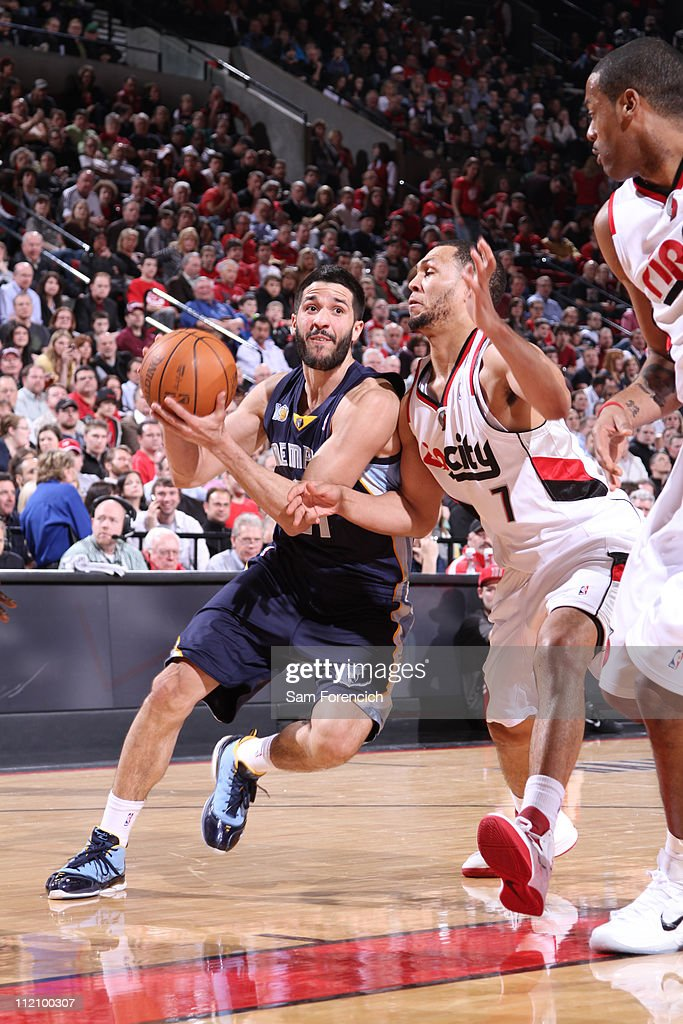 Greivis Vasquez #21 of the Memphis Grizzlies drives to the basket against Brandon Roy #7 of the Portland Trail Blazers on April 12, 2011 at the Rose Garden Arena in Portland, Oregon.