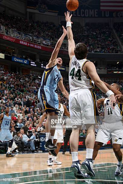 Greivis Vasquez of the Memphis Grizzlies shoots over Kyrylo Fesenko of the Utah Jazz at EnergySolutions Arena on January 1 2011 in Salt Lake City...