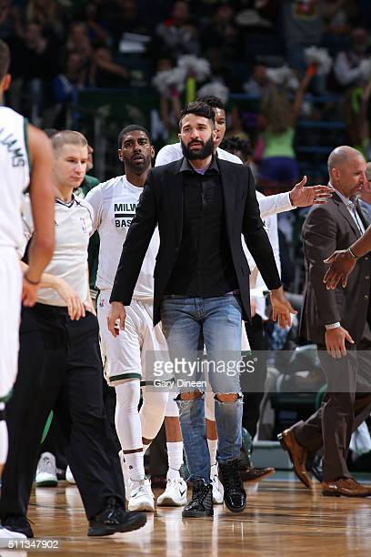 Greivis Vasquez of the Milwaukee Bucks cheers from the bench against the Charlotte Hornets on February 19 2016 at the BMO Harris Bradley Center in...