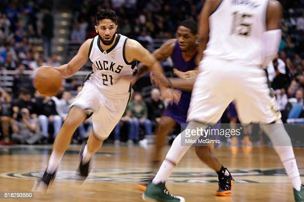 Greivis Vasquez of the Milwaukee Bucks drives to the hoop during the fourth quarter against the Phoenix Suns at BMO Harris Bradley Center on March 30...