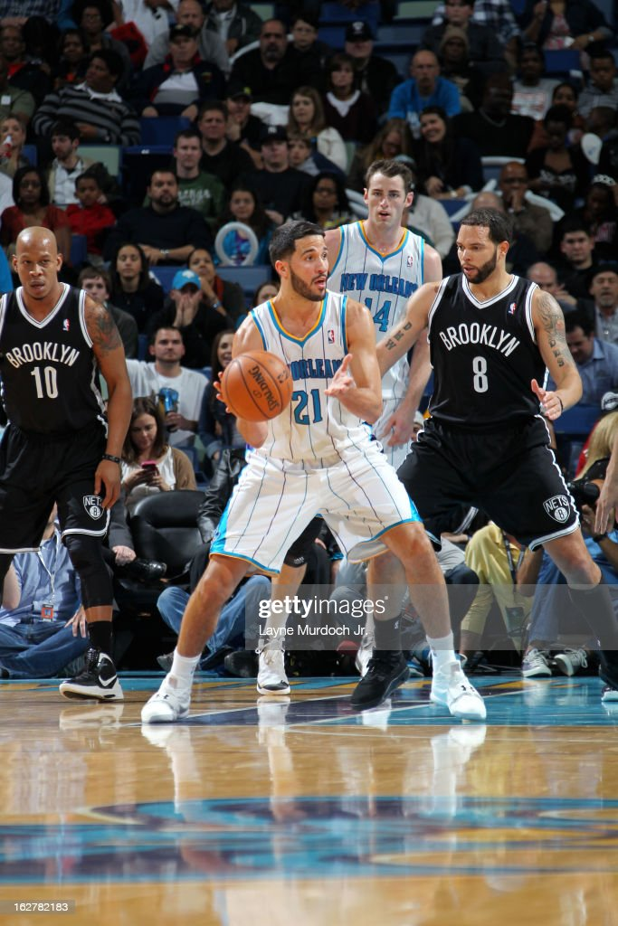 Greivis Vasquez #21 of the New Orleans Hornets handles the ball against Deron Williams #8 of the Brooklyn Nets on February 26, 2013 at the New Orleans Arena in New Orleans, Louisiana.