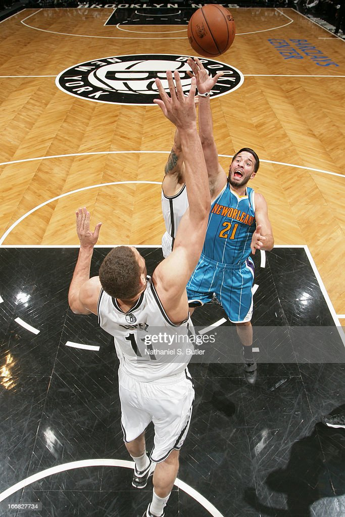Greivis Vasquez #21 of the New Orleans Hornets shoots against Brook Lopez #11 of the Brooklyn Nets on March 12, 2013 at the Barclays Center in the Brooklyn borough of New York City.