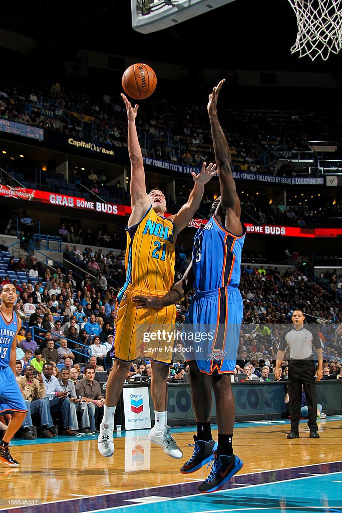 Greivis Vasquez #21 of the New Orleans Hornets shoots against Kendrick Perkins #5 of the Oklahoma City Thunder on November 16, 2012 at the New Orleans Arena in New Orleans, Louisiana.