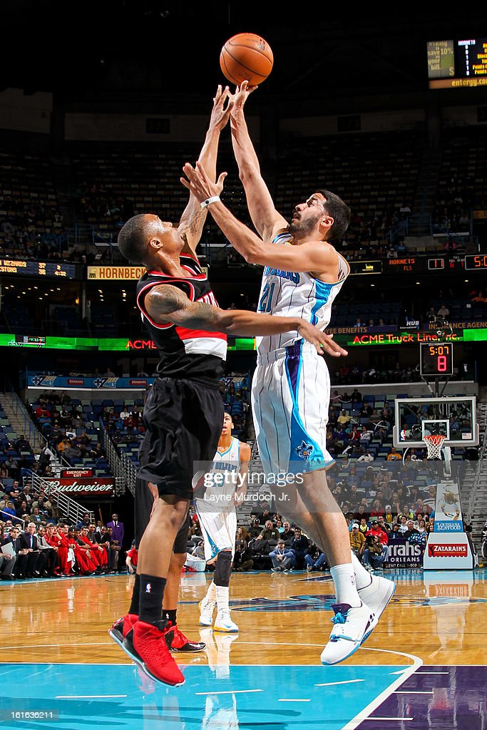 Greivis Vasquez #21 of the New Orleans Hornets shoots in the lane against Damian Lillard #0 of the Portland Trail Blazers on February 13, 2013 at the New Orleans Arena in New Orleans, Louisiana.