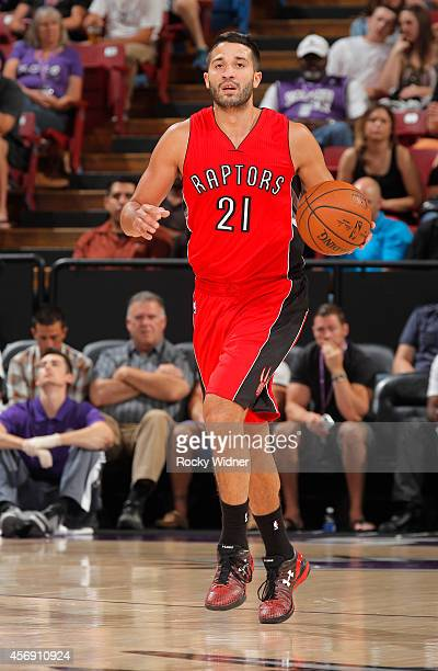 Greivis Vasquez of the Toronto Raptors brings the ball up the court against the Sacramento Kings on October 7 2014 at Sleep Train Arena in Sacramento...