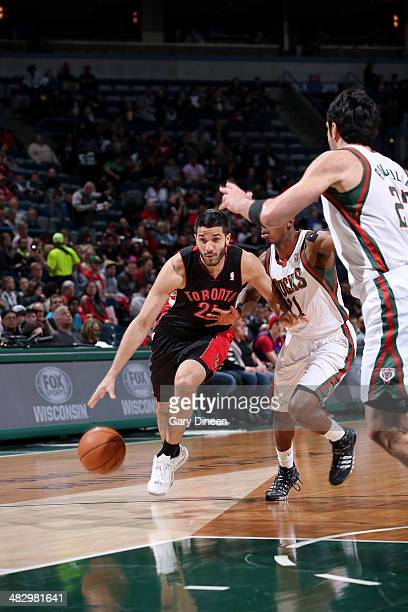Greivis Vasquez of the Toronto Raptors drives against the Milwaukee Bucks on April 5 2014 at the BMO Harris Bradley Center in Milwaukee Wisconsin...