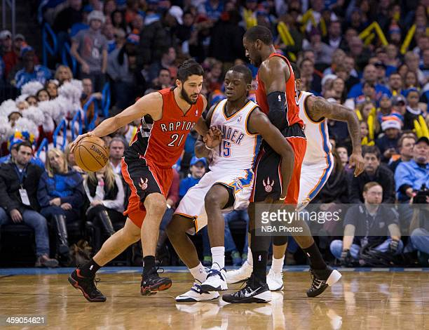 Greivis Vasquez of the Toronto Raptors handles the ball against Reggie Jackson of the Oklahoma City Thunder at the Chesapeake Arena on December 2013...