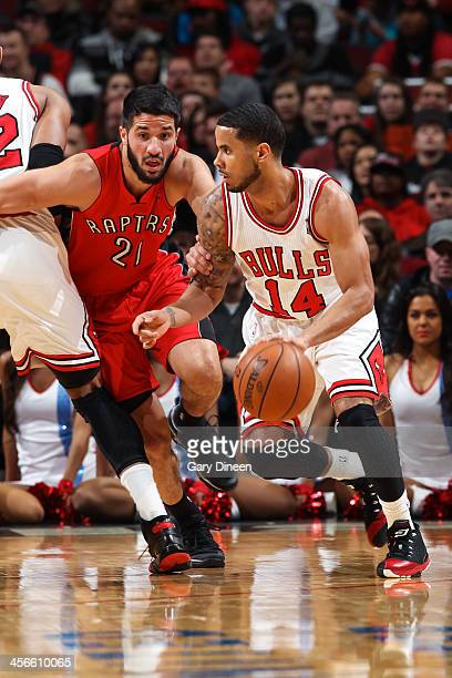Greivis Vasquez of the Toronto Raptors maneuvers around a screen to guard DJ Augustin of the Chicago Bulls on December 14 2013 at the United Center...