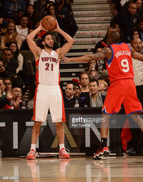 Greivis Vasquez of the Toronto Raptors passes the ball against the Philadelphia 76ers on December 13 2013 at the Air Canada Centre in Toronto Ontario...