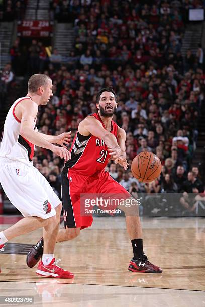 Greivis Vasquez of the Toronto Raptors passes the ball against the Portland Trail Blazers during the game on December 30 2014 at the Moda Center in...