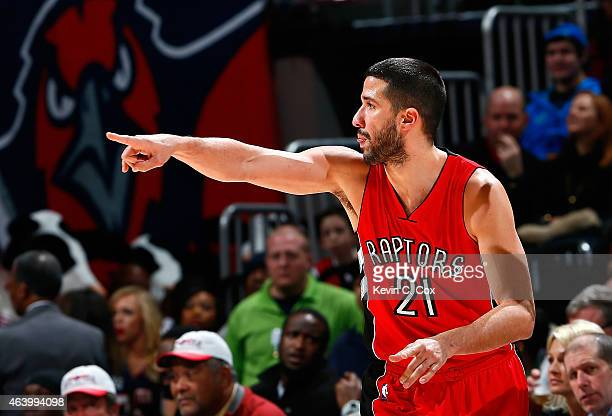 Greivis Vasquez of the Toronto Raptors reacts after hitting a threepoint basket against the Atlanta Hawks at Philips Arena on February 20 2015 in...