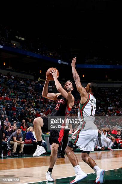 Greivis Vasquez of the Toronto Raptors shoots against Ramon Sessions of the Milwaukee Bucks on April 5 2014 at the BMO Harris Bradley Center in...