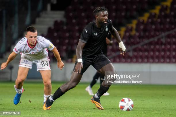 Grejohn Kyei of Servette FC battles for the ball with Marek Zsigmund of MFK Ruzomberok during the UEFA Europa League qualification match between...