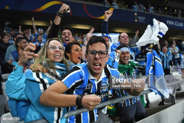 Gremio fans celebrate during the FIFA Club World Cup UAE 2017 semifinal match between Gremio FBPA and CF Pachuca on December 12 2017 at the Hazza bin...