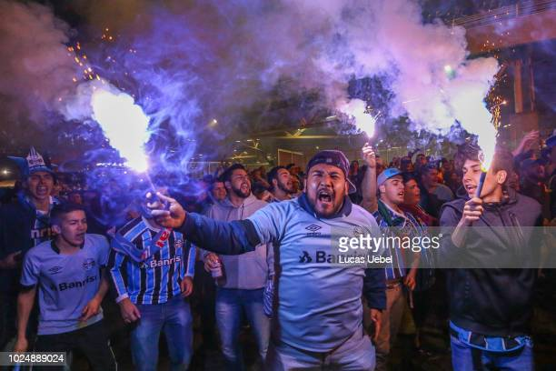 Gremio fans cheer for their team before the match between Gremio and Estudiantes as part of Copa Conmebol Libertadores 2018 at Arena do Gremio on...