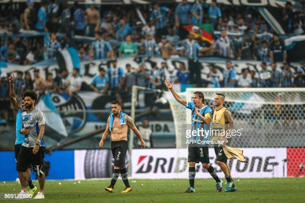 Gremio players celebrate after qualifying for the Copa Libertadores final at the Arena do Gremio stadium in Porto Alegre Brazil on November 01 2017 /...