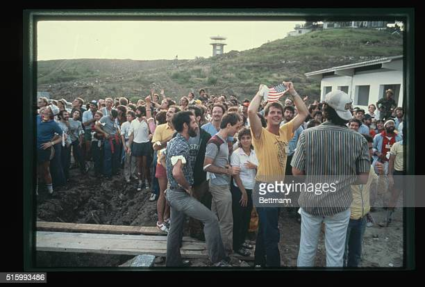 A group of American medical students wait by the airport for their evacuation during the United States invasion of the island of Grenada