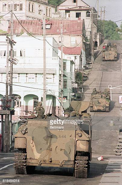 A United States combat personnel carrier drives down a street in Grenada during the United States invasion of the island of Grenada