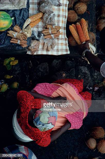 Grenada, St Georges, woman selling spices and corn, overhead view
