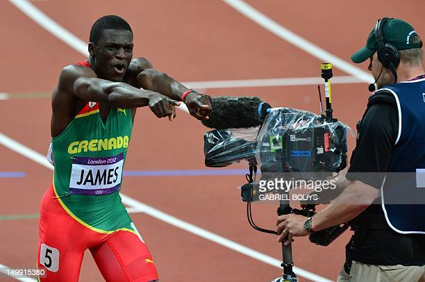 Grenada's Kirani James celebrates after winning the men's 400m final at the athletics event of the London 2012 Olympic Games on August 6 2012 in...