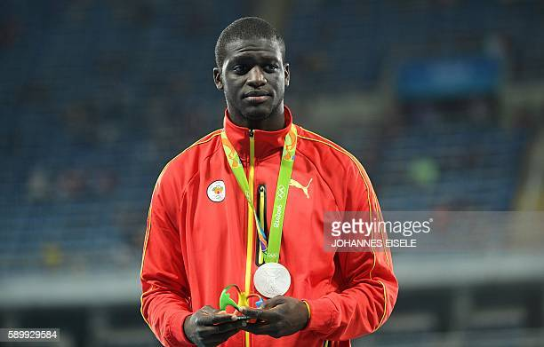 Grenada's Kirani James poses during the podium ceremony for the men's 400m during the athletics event at the Rio 2016 Olympic Games at the Olympic...