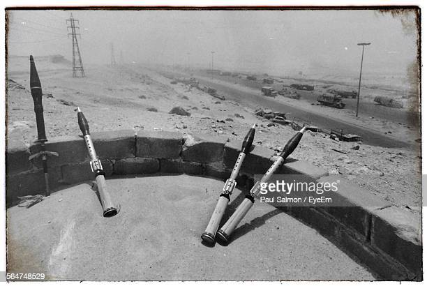 Grenade Launchers Leaning Against Stone Wall