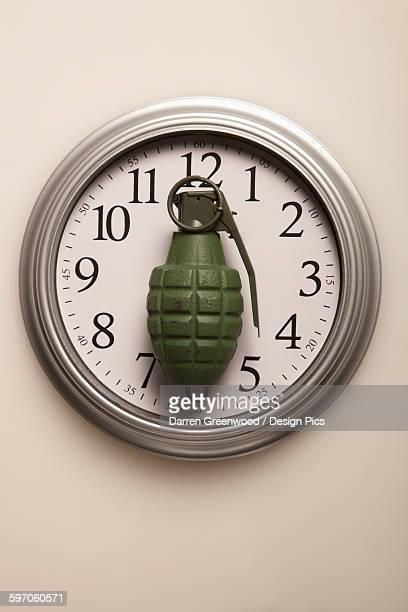 grenade on a clock - time bomb stock photos and pictures
