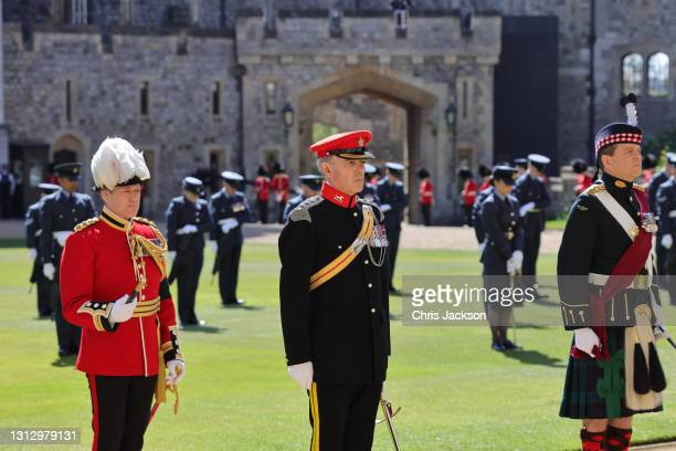 Grenadier Guardsman, A member of the Rifles and a member of The Highlanders, 4th Battalion, The Royal Regiment of Scotland during the funeral of...