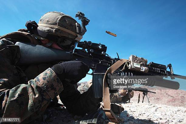 A grenadier provides suppressing fire during counter-ambush training.