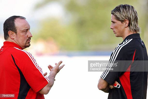 Liverpool FC team coach Rafael Benitez chats with the new Liverpool FC player Spanyard Fernando Torres prior to a preseason friendly game against...