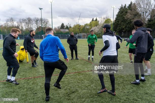 Grenfell Athletic FC's Head-Coach Rupert Taylor talks to his players during a football training session at Paddington Recreational Ground in north...
