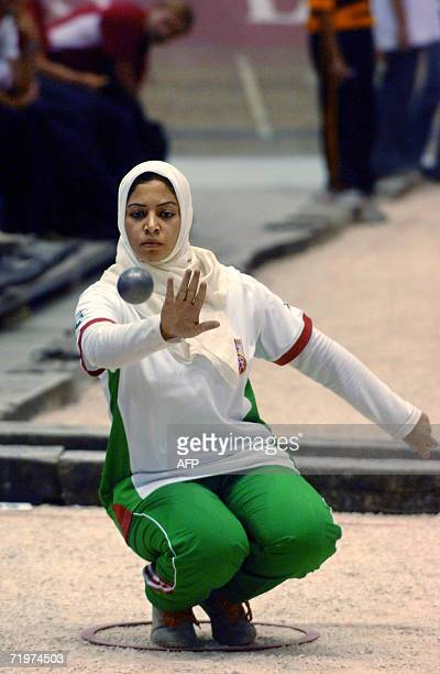 A member of the Algerian national team shoots straight during the World Petanque 42th Championships in Grenoble French Alps 22 September 2006 Some...